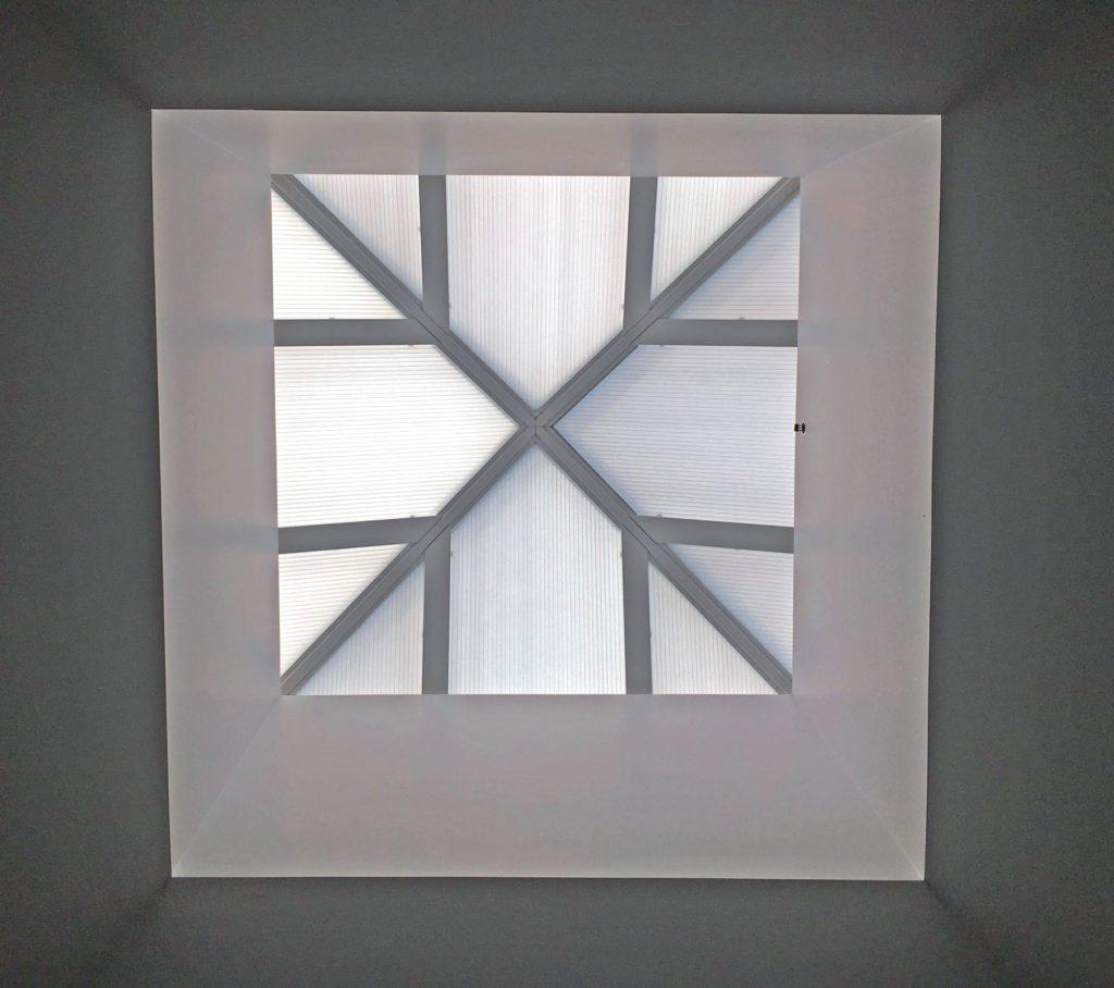 Sixteen Horizon S-Series Double Glazed Pyramids, 9' x 9', 6/12 pitch. Glazing: 25mm Opal over 16mm Opal Cellular Polycarbonate. Finish: Kynar 500 Bone White on frames.
