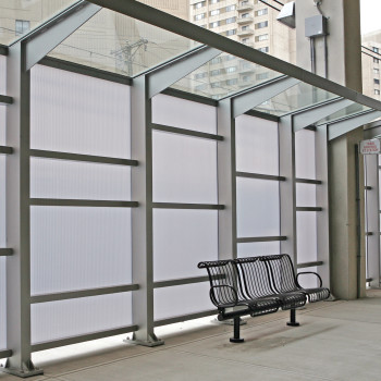 "Sloped: 7/16"" Clear HS Laminated; Vertical 16mm Opal Cellular Polycarbonate"
